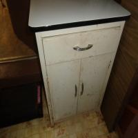White metal base cabinet and contents