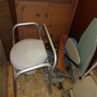 Handicap commode, tabletop ironing board and assorted items